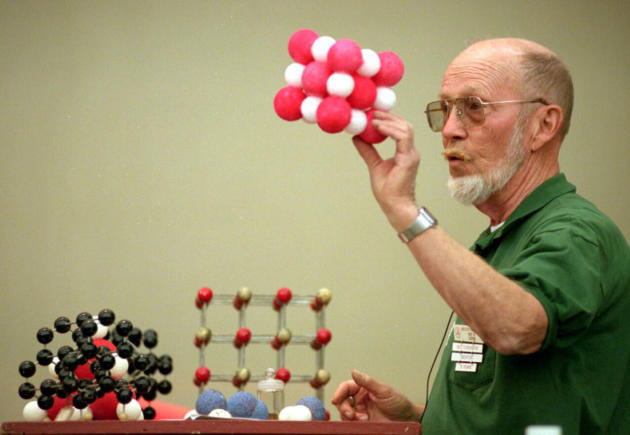 Roy Caton holds up a model of a salt crystal during a lecture on chemistry for gardeners in 2000. (Eddie Moore/Albuquerque Journal)